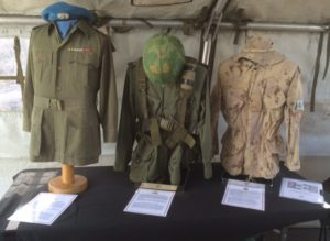 L-R Bush Jacket, 1963 Pattern Combat Shirt, Webbing and Helmet; CADPAT jacket and Boonie Hat