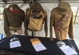 L-R 1948 Pattern Battle Dress Blouse and CLC Helmet; 1939 Patter Battle Dress Blouse, Webbing with Gas Mask Bag and Helmet; and 1903 Pattern Service Dress, Cloth Cap, Leather Belt and Bandoleer.