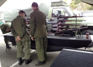 Colin Wyatt and Peter Laursen preparing the weapons display